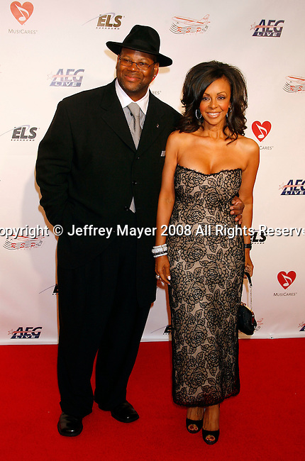 LOS ANGELES, CA. - February 06: Producer Jimmy Jam and wife Lisa Padilla arrive at the 2009 MusiCares Person of the Year Tribute to Neil Diamond at the Los Angeles Convention Center on February 6, 2009 in Los Angeles, California.