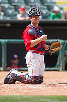 Oklahoma City RedHawks catcher Max Stassi (10) behind the plate during the Pacific League game at the Chickasaw Bricktown Ballpark against the New Orleans Zephyrs on April 13, 2014 in Oklahoma City, Oklahoma.  The RedHawks defeated the Zephyrs 4-3.  (William Purnell/Four Seam Images)