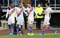 Crystal Palace's Wilfried Zaha (left) celebrates with team-mates Patrick van Aanholt, James McArthur and Luka Milivojevic after scoring the opening goal <br /> <br /> Photographer Rich Linley/CameraSport<br /> <br /> The Premier League - Burnley v Crystal Palace - Saturday 30th November 2019 - Turf Moor - Burnley<br /> <br /> World Copyright © 2019 CameraSport. All rights reserved. 43 Linden Ave. Countesthorpe. Leicester. England. LE8 5PG - Tel: +44 (0) 116 277 4147 - admin@camerasport.com - www.camerasport.com