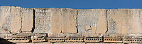 Dedication inscription on top of the Triumphal Arch of Caracalla, built 217 AD by the city's governor Marcus Aurelius Sebastenus at the end of the Decumanus Maximus in honour of Emperor Caracalla, 188-217 AD, and his mother Julia Domna, Volubilis, Northern Morocco. The arch was reconstructed 1930-34 and was originally topped with a bronze chariot pulled by 6 horses. Volubilis was founded in the 3rd century BC by the Phoenicians and was a Roman settlement from the 1st century AD. Volubilis was a thriving Roman olive growing town until 280 AD and was settled until the 11th century. The buildings were largely destroyed by an earthquake in the 18th century and have since been excavated and partly restored. Volubilis was listed as a UNESCO World Heritage Site in 1997. Picture by Manuel Cohen