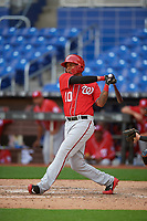 Washington Nationals Gilbert Lara (10) follows through on a swing during a Florida Instructional League game against the Miami Marlins on September 26, 2018 at the Marlins Park in Miami, Florida.  (Mike Janes/Four Seam Images)