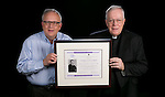 The Rev. Edward R. Udovic, C.M., secretary of the university, left, and the Rev. John E. Rybolt, C.M., Vincentian scholar-in-residence, with the Vincentian Studies Institute's Pierre Coste Prize. Rybolt received the honor in part for his recently published seven-volume global history of the Vincentian community that dates back to its beginning in 1625. The award is named after the distinguished French Vincentian historian Pierre Coste, C.M., who worked during the first part of the 20th century. Coste is considered the father of modern Vincentian studies. (DePaul University/Jeff Carrion)