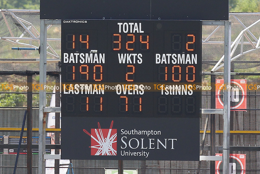 The scoreboard shows that Hamsphire batsmen James Vince (190) and Will Smith (100) have compiled 300 runs for the 3rd wicket - Hampshire CCC vs Essex CCC - LV County Championship Division Two Cricket at the Ageas Bowl, West End, Southampton - 17/06/14 - MANDATORY CREDIT: Gavin Ellis/TGSPHOTO - Self billing applies where appropriate - 0845 094 6026 - contact@tgsphoto.co.uk - NO UNPAID USE