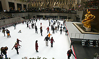 Skaters on the ice rink at Rockefeller Center, New York City, December 2003.(Photo by Brian Cleary/www.bcpix.com) New York City, December 2003.  (Photo by Brian Cleary/www.bcpix.com)