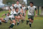 T. Tutuila gets his pass away under the watchful eye S. Fishulau. Counties Manukau Premier 1 McNamara Cup round 2 rugby game between Manurewa & Waiuku played at Mountfort Park, Manurewa on the 30th of June 2007. Manurewa led 19 - 3 at halftime and went on to win 31 - 3.