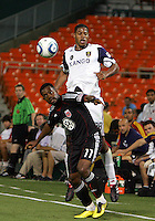 Luciano Emilio #11 of D.C. United  is hit in the back by Chris Schuler #28 of Real Salt Lake during an Open Cup match at RFK Stadium, on June 2 2010 in Washington DC. DC United won 2-1.