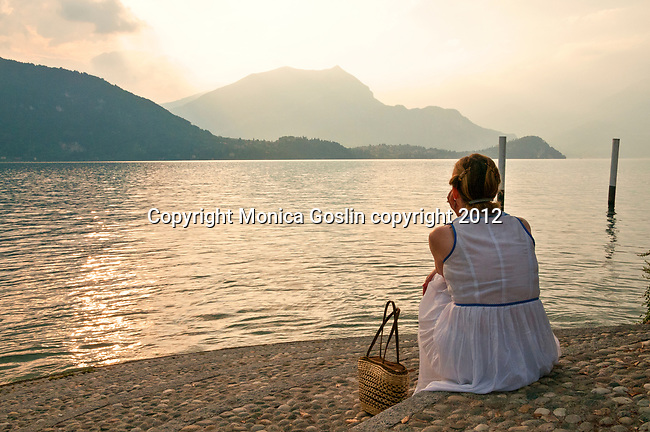 Looking at the view of Lake Como at sunset from the waterfront walkway in the town of Lierna, across the lake from Bellagio