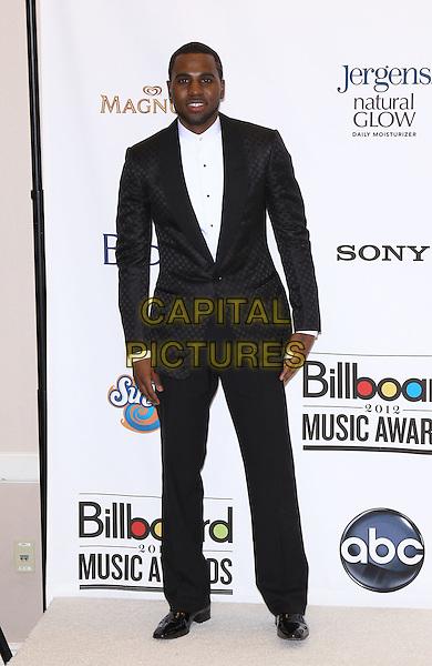 Jason Derulo.2012 Billboard Music Awards Press Room at the MGM Grand Garden Arena Las Vegas, Las Vegas, Nevada, USA..May 20th, 2012.full length white shirt black suit .CAP/ADM/MJT.© MJT/AdMedia/Capital Pictures.