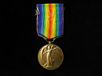 BNPS.co.uk (01202 558833)<br /> Pic: Lockdales/BNPS<br /> <br /> The Victory Medal awarded to Major George Scott CBE. <br /> <br /> The tragic tale of a pioneering pilot who made the first east-west transatlantic crossing in an airship can be told after his campaign medal emerged for sale 101 years later.<br /> <br /> Major George Scott CBE, who served in the Royal Naval Air Service and RAF in World War One, made headlines in 1919 when he commanded the airship R34 for its historic voyage.<br /> <br /> The arduous flight from East Fortune in Scotland to Mineola airfield in New York took 108 hours and 12 minutes, during which they 'dodged storms and ran low on fuel and hydrogen'. He was praised for his 'cool, alert and expert handling' of the 643ft long airship, and granted an audience with the American President Woodrow Wilson. <br /> <br /> However, his life ended in tragedy 11 years later when the R101 airship crashed on its maiden overseas voyage in northern France en route to India. Forty-eight people were killed in the disaster on October 5, 1930.<br /> <br /> Now, his Victory Medal, which was discovered by the vendor in a 'junk box' of old medals, is going under the hammer with Lockdales Auctioneers, of Ipswich, Suffolk.