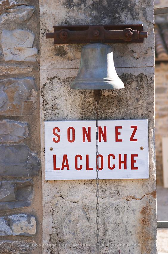 Ring the bell. A substantial bell. Domaine de Mas de Martin, St Bauzille de Montmel. Gres de Montpellier. Languedoc. France. Europe.