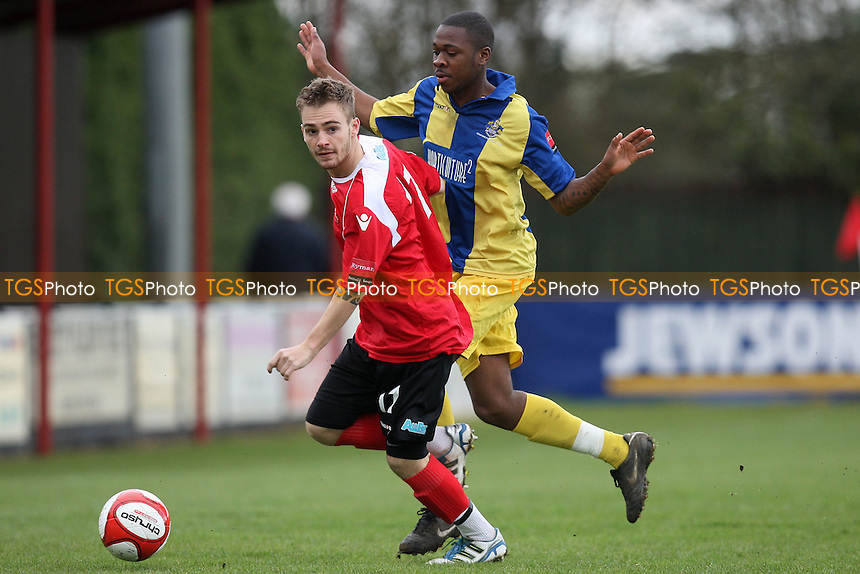 Scott Chaplin of Needham Market and David Ottley of Romford - Needham Market vs Romford - Ryman League Division One North Football at Bloomfields - 14/04/12 - MANDATORY CREDIT: Gavin Ellis/TGSPHOTO - Self billing applies where appropriate - 0845 094 6026 - contact@tgsphoto.co.uk - NO UNPAID USE.