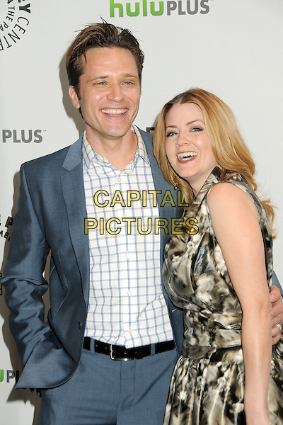 "Seamus Dever, Juliana Dever.PaleyFest 2012 Presents ""Castle"" held at The Saban Theatre, Beverly Hills, California, USA, 9th March 2012..half length blue jacket white checked shirt print dress  grey gray print suit belt black .CAP/ADM/BP.©Byron Purvis/AdMedia/Capital Pictures."
