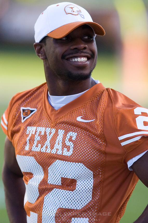 30 September 2006: Injured Texas back Selvin Young smiles at fans in the crowd from the sidelines during the Longhorns 56-3 victory over the Sam Houston State Bearkats at Darrell K Royal Memorial Stadium in Austin, TX.