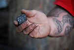 Shawn Thatcher holds a small piece of coal near Quicksand, KY on October 14th, 2011. Photo by Lauryn Morris.