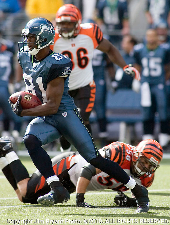 Seattle Seahawks wide receiver Nate Burleson makes Cincinnati Bengals linebacker Anthony Schelegel miss a tackle after catching a 19-yard pass in the first quarter at Qwest Field in Seattle on September 23, 2007. Burleson caught nine passes for 77 yards and the winning touchdown pass with one minute remaining in the Seahawks 24-21 win over the Bengals. Jim Bryant Photo. ©2010. All Rights Reserved.