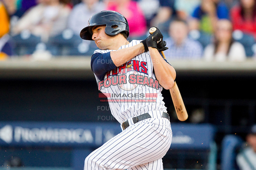 Nick Castellanos (23) of the Toledo Mudhens follows through on his swing against the Charlotte Knights at 5/3 Field on May 3, 2013 in Toledo, Ohio.  The Knights defeated the Mudhens 10-2.  (Brian Westerholt/Four Seam Images)