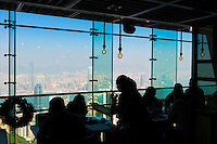 Silhouette of the people in the restaurant on Victoria Peak observation viewpoint, Hong Kong