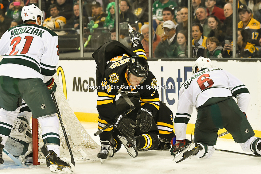 March 17, 2014 - Boston, Massachusetts , U.S. - Boston Bruins center Carl Soderberg (34) trips over center Chris Kelly (23) during the NHL game between the Minnesota Wild and the Boston Bruins held at TD Garden in Boston Massachusetts. The Bruins defeated the Wild 4-1 at the end of regulation.  Eric Canha/CSM