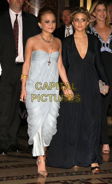 MARY KATE OLSEN & ASHLEY OLSEN.The 9th annual ACE Awards at Cipriani 42nd St., New York, NY..November 8th, 2005.Photo: Jackson Lee/Admedia/Capital Pictures.Ref: JL/ADM.full length black dress blue strapless twins sisters siblings holding hands.www.capitalpictures.com.sales@capitalpictures.com.© Capital Pictures.