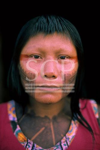 A - Ukre village, Xingu, Brazil. Kayapo woman with red and black body paint.