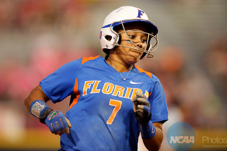 02 JUNE 2014:   Kelsey Stewart (7) of the University of Florida rounds third base against the University of Alabama during the Division I Women's Softball Championship held at ASA Hall of Fame Stadium in Oklahoma City, OK.  Shane Bevel/NCAA Photos