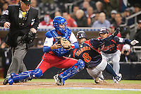 18 March 2009: #8 Akinori Iwamura of Japan slides safely at home against #8 Ariel Pestano of Cuba during the 2009 World Baseball Classic Pool 1 game 5 at Petco Park in San Diego, California, USA. Japan wins 5-0 over Cuba.