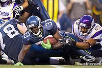 Seattle Seahawks running back Leon Washington (33) is tackled by Minnesota Vikings safety Tyrell Johnson (25) at CenturyLink Field in Seattle, Washington. The Minnesota Vikings won the game, 20-7.