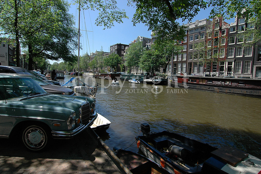 Streetscape in Amsterdam with an oldtimer Mercedes in the foreground