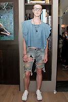 """Model poses in an outfit from the Christopher Lowman Spring Summer 2018 """"Harvard Punk'd"""" collection at HGU New York, on July 10, 2017; during New York Fashion Week: Men's Spring Summer 2018."""