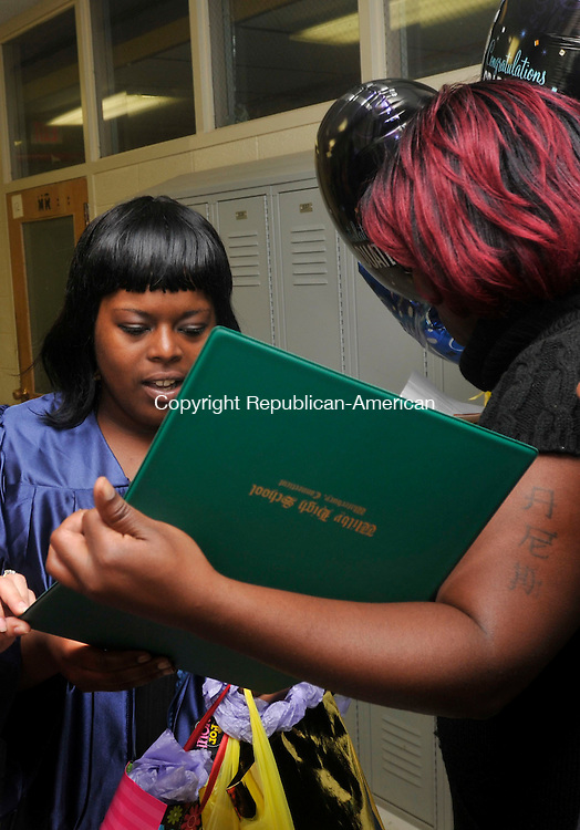 WATERBURY, CT- 11 June 2010 - 061110IP12- State Street High School graduate Dennaysia Newton looks at her diploma with her mother Talisha Newton after the Alternative Programs Commencement Ceremony for Enlightenment School, Excel Programs and State Street School at Mattatuck Museum in Waterbury on Friday.<br /> Irena Pastorello Republican-American