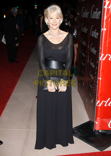 HELEN MIRREN.The 21st Annual Palm Springs International Film Festival held at The Civic Center in Palm Springs, California, USA. .January 5th, 2010.full length black dress maxi clutch bag belt sheer sleeves .CAP/RKE/DVS.©DVS/RockinExposures/Capital Pictures.