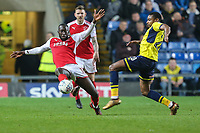 Toumani Diagourage of Fleetwood Town under pressure from Jonathan Obika of Oxford United during the Sky Bet League 1 match between Oxford United and Fleetwood Town at the Kassam Stadium, Oxford, England on 10 April 2018. Photo by David Horn.