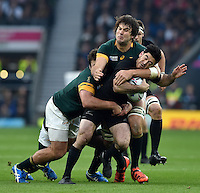 Nehe Milner-Skudder of New Zealand is tackled by Lood de Jager of South Africa. Rugby World Cup Semi Final between South Africa and New Zealand on October 24, 2015 at Twickenham Stadium in London, England. Photo by: Patrick Khachfe / Onside Images