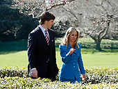 New York Giants quarterback Eli Manning speaks with fitness celebrity Denise Austin as they arrive for United States President George W. Bush's statement on the National President's Challenge in the East Garden of the White House, Washington DC on March 20, 2008.<br /> Credit: Aude Guerrucci / Pool via CNP