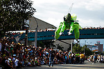 """A reveller disguised as cricket jumps while he attends the traditional """"Silletero"""" parade during the Flower Festival in Medellin August 7, 2012. Photo by Eduardo Munoz Alvarez / VIEW."""
