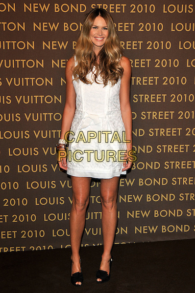 ELLE MACPHERSON .attends the launch of the Louis Vuitton Bond Street Maison in London, England, UK, May 25th, 2010..full length sleeveless white dress peep toe black shoes bracelet tanned summery .CAP/PL.©Phil Loftus/Capital Pictures.