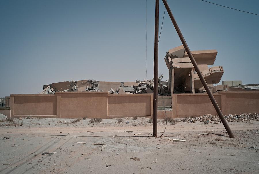 House destroyed by NATO strike in Bir Ayad, Libya.