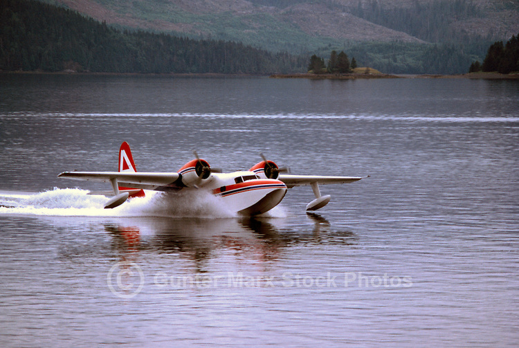 Haida Gwaii (Queen Charlotte Islands), Northern BC, British Columbia, Canada - Float Plane touching down in Skidegate Inlet, Graham Island