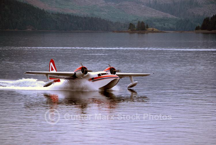 Haida Gwaii (Queen Charlotte Islands), Northern BC, British Columbia, Canada - Float Plane touching down in Skidegate Inlet, Graham Island
