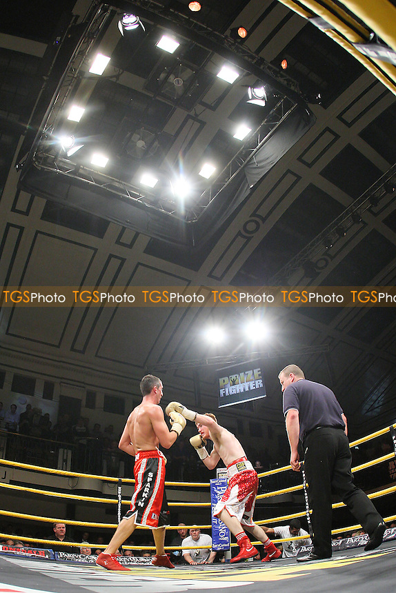 A general view as Nick Quigley (red/white shorts) defeats Steve Harkin (red/black shorts) in Quarter-Final Four of Prizefighter The Light-Middleweights II at York Hall, Bethnal Green, promoted by Matchroom Sports - 15/09/11 - MANDATORY CREDIT: Gavin Ellis/TGSPHOTO - Self billing applies where appropriate - 0845 094 6026 - contact@tgsphoto.co.uk - NO UNPAID USE.