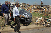 United States President Barack Obama and Missouri Governor Jay Nixon walk together during a visit to the community that was devastated a week ago by a tornado on May 29, 2011 in Joplin, Missouri. The tornado, which was packing winds of more than 200 mph, is now considered to hold the record for the highest death toll in U.S. history.  .Credit: Joe Raedle / Pool via CNP