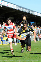 Hugo Southwell of London Wasps dives over to score a try during the Aviva Premiership match between London Wasps and Gloucester Rugby at Adams Park on Sunday 1st April 2012 (Photo by Rob Munro)