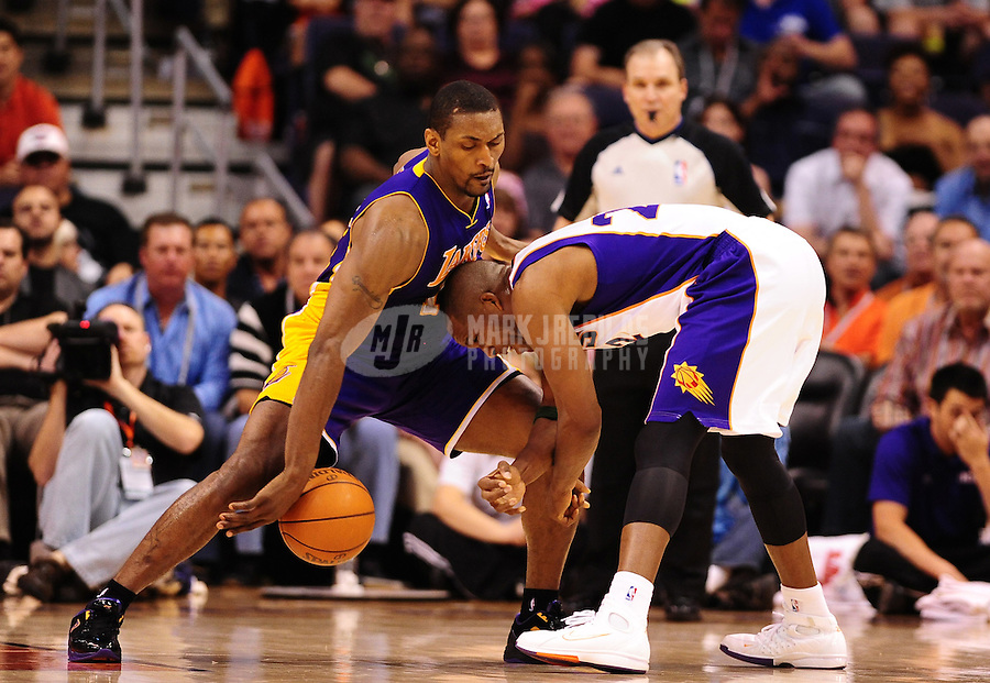 Apr. 7, 2012; Phoenix, AZ, USA; Los Angeles Lakers forward (15) Metta World Peace knocks the ball from the hands of Phoenix Suns guard (22) Michael Redd in the first half at the US Airways Center. Mandatory Credit: Mark J. Rebilas-.