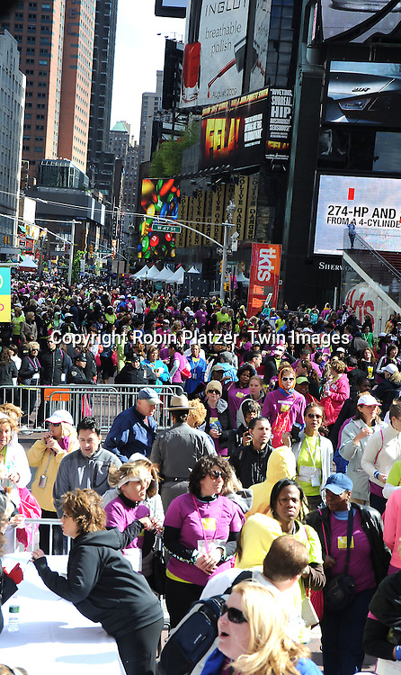 the crowd walking at  O, The Oprah Magazine's 10th Anniversary celebration Live Your Best Life Walk on May 9, 2010 in Times Square in New York City.