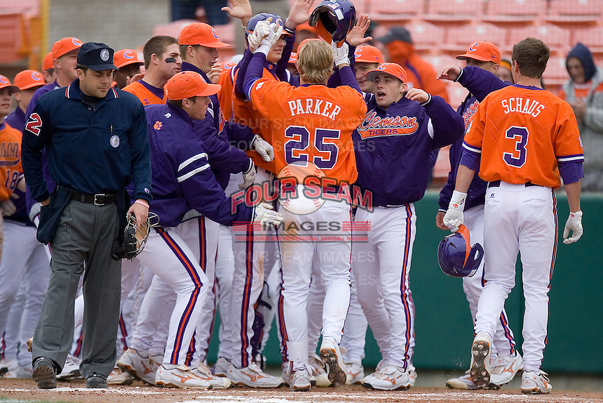 Kyle Parker #25 of the Clemson Tigers is congratulated by his teammates after hitting a 2-run home run versus the Wake Forest Demon Deacons at Doug Kingsmore stadium March 13, 2009 in Clemson, SC. (Photo by Brian Westerholt / Four Seam Images)