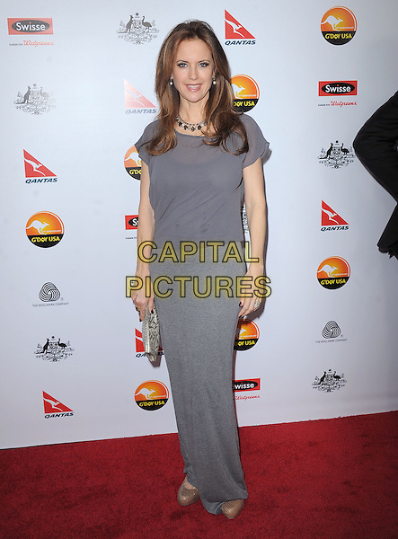 Kelly Preston.at The G'Day USA Black Tie Gala held at The JW Marriot at LA Live in Los Angeles, California, January 12th 2013.                                                                 .full length grey gray top dress  long maxi clutch bag .CAP/DVS.©Debbie VanStory/Capital Pictures.