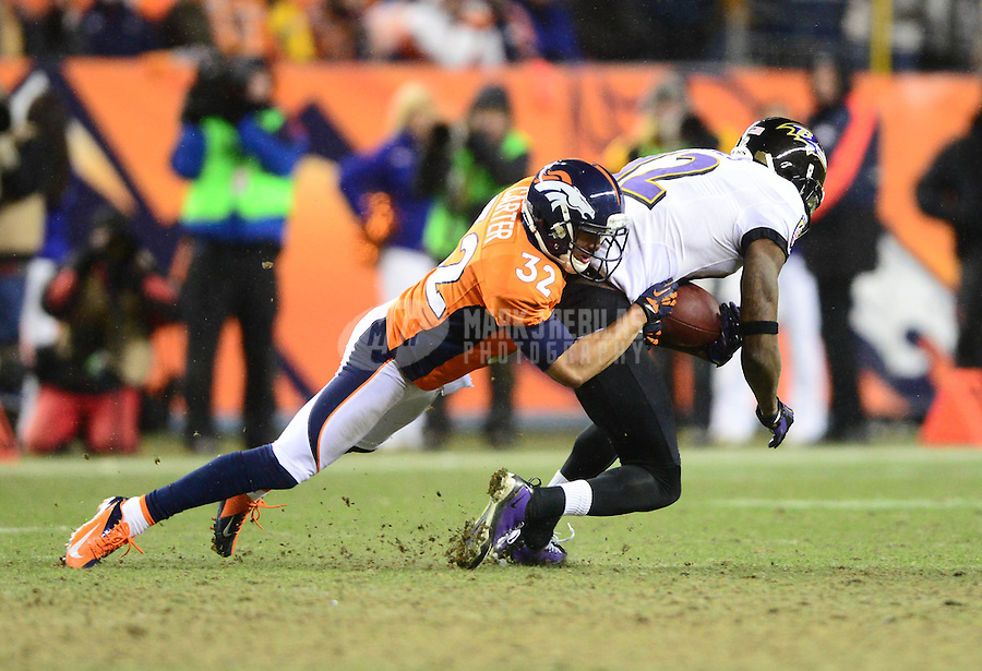 Jan 12, 2013; Denver, CO, USA; Baltimore Ravens wide receiver Jacoby Jones (12) is tackled by Denver Broncos cornerback Tony Carter (32) during the AFC divisional round playoff game at Sports Authority Field.  Mandatory Credit: Mark J. Rebilas-
