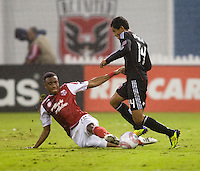 Rodeny Wallace (22) of the Portland Timbers tackles the ball away from Andy Najar (14) of D.C. United during the game at RFK Stadium in Washington, D.C. D.C. United tied the Portland Timbers, 1-1.