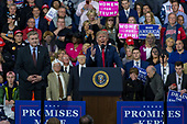 United States President Donald J. Trump speaks as Rick Saccone, Republican Congressional candidate for Pennsylvania's 18th district, looks on during a Make America Great Again campaign rally at Atlantic Aviation in Moon Township, Pennsylvania on March 10th, 2018. Credit: Alex Edelman / CNP