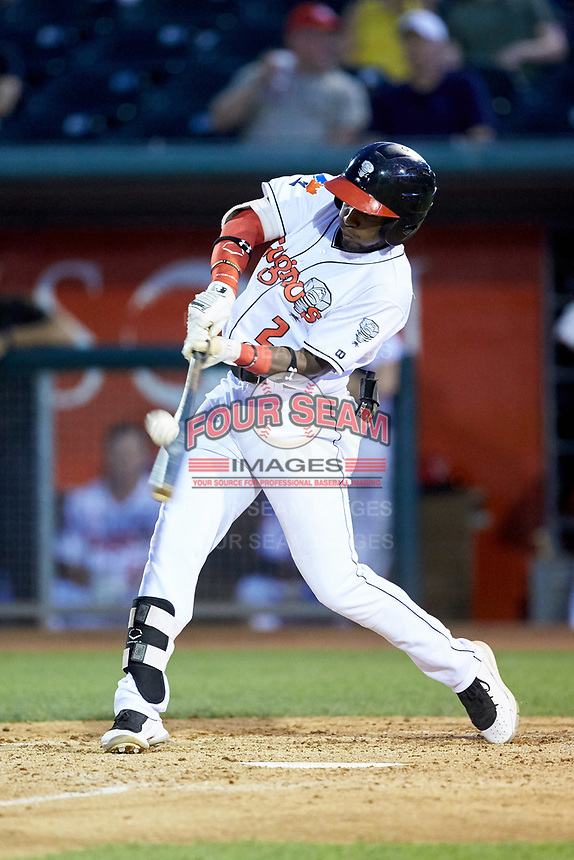 Chavez Young (2) of the Lansing Lugnuts makes contact with the baseball during the game against the South Bend Cubs at Cooley Law School Stadium on June 15, 2018 in Lansing, Michigan. The Lugnuts defeated the Cubs 6-4.  (Brian Westerholt/Four Seam Images)